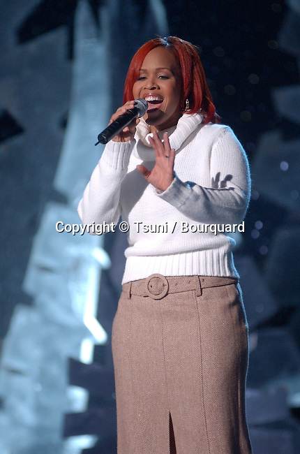 Mary (from Mary Mary) performing at the 2001 Soul Train Christmas Starfest, in Santa Monica Auditorium in Los Angeles. November 20, 2001.          -            Mary_Mary_concert14.jpg