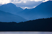Looking across Lake Manapouri to the Kepler Mountains, Fiordland National Park, South Island, New Zealand.