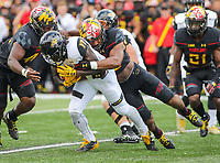 College Park, MD - September 9, 2017: Towson Tigers cornerback Justice Pettus-Dixon (17) gets tackled during game between Towson and Maryland at  Capital One Field at Maryland Stadium in College Park, MD.  (Photo by Elliott Brown/Media Images International)