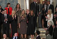 First lady Melania Trump waves as she arrives prior to United States President Donald J. Trump delivering his second annual State of the Union Address to a joint session of the US Congress in the US Capitol in Washington, DC on Tuesday, February 5, 2019.  Pictured standing with the first lady, from left to right: Senior Advisor Jared Kushner, First Daughter and Advisor to the President Ivanka Trump, Lara Trump, and Tiffany Trump.<br /> Credit: Alex Edelman / CNP/AdMedia