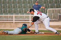 First baseman Jorge Castillo (28) of the Kannapolis Intimidators applies a tag to Shane Jordan (2) of the Augusta GreenJackets at Fieldcrest Cannon Stadium in Kannapolis, NC, Wednesday August 20, 2008. (Photo by Brian Westerholt / Four Seam Images)