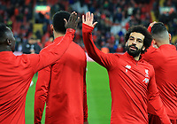 24th February 2020; Anfield, Liverpool, Merseyside, England; English Premier League Football, Liverpool versus West Ham United; Mohammed Salah of Liverpool  high fives team mate Naby Keita