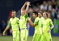 Seattle Sounders FC midfielder Osvaldo Alonso, second from left, celebrates scoring a goal with teammates, from left, Roger Levesque, Leonardo Gonzalez, and Erik Friberg during play between the Seattle Sounders FC and the Chicago Fire in the U.S. Open Cup Final at CenturyLink Field in Seattle Tuesday October 4, 2011. Seattle won the game 2-0 to win its third U.S. Open Cup.