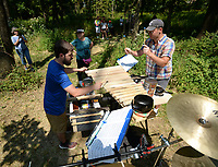 NWA Democrat-Gazette/ANDY SHUPE<br /> Chris Scherer (left) and Carson Vanduch, (right) both musicians with the Fayetteville band Thought Form Collective, perform music Saturday, Sept. 7, 2019, for visitors during a tour of the Wilson Springs Preserve in Fayetteville. The Northwest Arkansas Land Trust has been working for seven years to preserve and restore the 121-acre prairie wetland and opened the area to visitors with Immerse, a nature and arts festival.