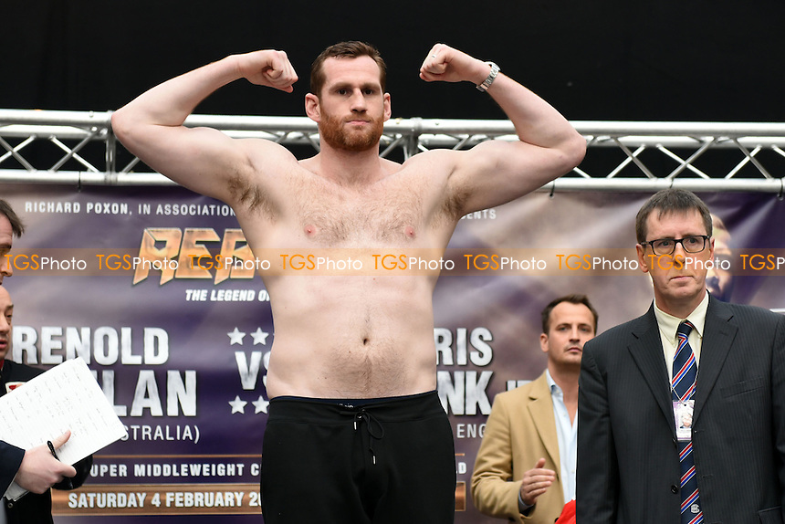 Boxer David Price on the scales during a Poxon Sports Weigh-In at Westfield Shopping Centre on 3rd February 2017