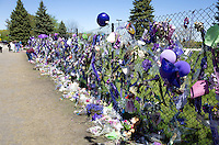 Long view of Prince memorial fence with fans mourning the death of Prince. Paisley Park Studios Chanhassen Minnesota MN USA