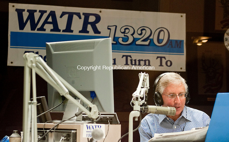 WATERBURY, CT -25 SEPTEMBER 2012--092512JS08- Larry Rifkin of WATR Radio in Waterbury, talks with a caller during his show Talk of the Town on Tuesday. .Jim Shannon Republican-American