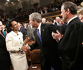 United States President George W. Bush shakes hands US Secretary of State Condoleezza Rice, left, as he arrives to give his fifth State of the Union speech Tuesday, January 31, 2006, on Capitol Hill in Washington. At right is Chief Justice of the United States John G. Roberts, Jr.<br /> Credit: Pablo Martinez Monsivais / Pool via CNP
