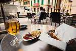 Tapas and beer at a street side tavern in the central plaza, Llucmajor, Mallorca