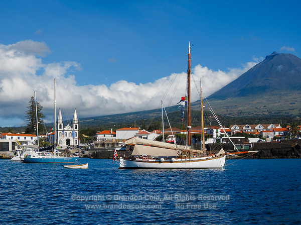 WQ6614-D. Town of Madalena, showing the harbor and waterfront and church, with Mount Pico in background. This volcano on Pico Island in the Azores is 7713 feet high, and the tallest mountain in all of Portugal. Pico Island, Azores, Portugal, Atlantic Ocean.<br /> Photo Copyright © Brandon Cole. All rights reserved worldwide.  www.brandoncole.com