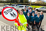 Noreen Lynch, Rathmore on her last had as traffic warden ouside St Josephs NS Rathmore on Friday with back l-r: Ciara Hughes, Eoin Cashman, Liam O'Keeffe. Back row: Daniel Sheehan, James Lucey, Anna Cashman, Michael Dennehy, Mia Reen and Aimee Cremin