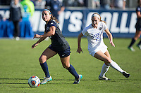 Cary, North Carolina - Sunday December 6, 2015: Nickolette Driesse (23) of the Penn State Nittany Lions keeps the ball away from Kara Wilson (15) of the Duke Blue Devils during second half action at the 2015 NCAA Women's College Cup at WakeMed Soccer Park.  The Nittany Lions defeated the Blue Devils 1-0.