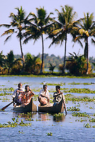Aleppey, alappuzha, Kerala, India, April 2008. Fishermen pass our houseboat. The houseboat, a converted kettuvalom rice barge, glides through the backwaters while daily life on the shore passes by. The backwaters of Kerala are reknowned for its rich history and its importance for the spice trade. Photo by Frits Meyst/Adventure4ever.com
