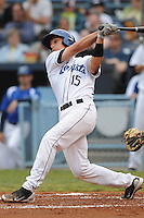 Asheville Tourists Dustin Garneau #15 swings at a pitch during a game against  the Lexington Lengends at McCormick Field in Asheville,  North Carolina;  April 18, 2011. Asheville defeated Lexington 4-1.  Photo By Tony Farlow/Four Seam Images