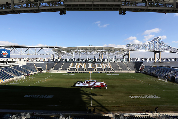 15 December 2013: A wide shot of the field before the game as they practice the national anthem. The University of Maryland Terripans played the University of Notre Dame Fighting Irish at PPL Park in Chester, Pennsylvania in a 2013 NCAA Division I Men's College Cup championship match.