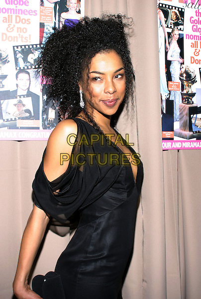 SOPHIE OKONEDO.Miramax , Coors Light, AMC & Glamour Magazine present the 2005 Golden Globes After-Party held Trader Vic's in the Beverly Hilton Hotel. Beverly Hills, California..January 16th, 2005.Photo Credit: Jacqui Wong/AdMedia..half length, black dress, sheer, shoulder.www.capitalpictures.com.sales@capitalpictures.com.© Capital Pictures.