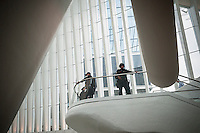 Counterterrorism officers on guard at the World Trade Center Transportation Hub, known as the Oculus, on Tuesday, August 16, 2016 during the grand opening of the retail spaces. The 350,000 square foot retail space will feature over 100 stores when they all open, including a now opened Apple Store. The mall opens almost 15 years after the World Trade Center terrorist attack.  (© Richard B. Levine)
