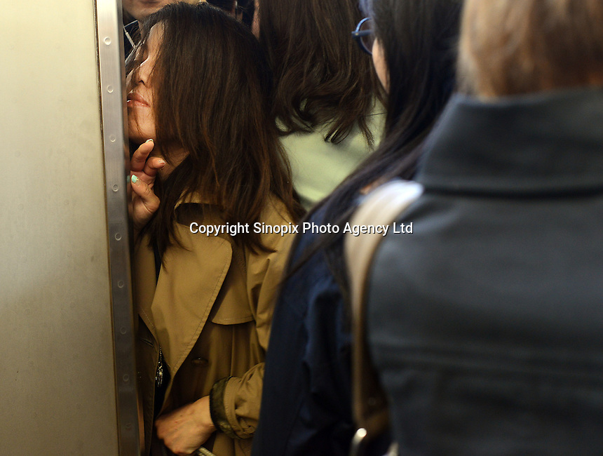 A passengers squeezes herself onto a train during morning rush hour, Shinjuku Station, Tokyo. With up to 4 million passengers passing through it every day, Shinjuku station, Tokyo, Japan, is the busiest train station in the world. The station was used by an average of 3.64 million people per day.  That&rsquo;s 1.3 billion a year.  Or a fifth of humanity. Shinjuku has 36 platforms, and connects 12 different subway and railway lines.  Morning rush hour is pandemonium with all trains 200% full. <br /> <br /> Photo by Richard jones / sinopix