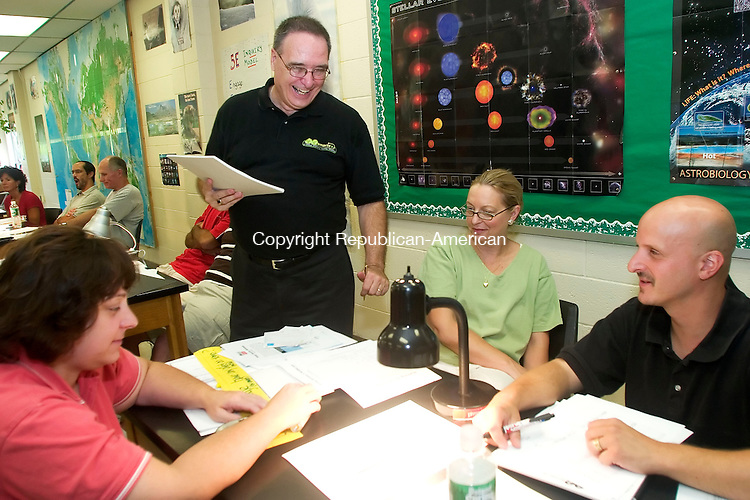 WATERBURY, CT - 27 AUG 07- 082707JT10-<br /> Sitting down from left, Kathy Gaydosh, chemistry teacher at Kennedy, Nancy Alexander, chemistry teacher at Crosby, and Jerry Genua, biology and chemistry teacher at Crosby, talk with Robert Borello as they conduct an experiment during a workshop led by Borello for science teachers in Waterbury on how to teach energy efficiency to kids on Monday at Wilby High School. The program, called EE Smarts, is run by CL&amp;P and is free for the school system, paid for out of the energy conservation fund.<br /> Josalee Thrift / Republican-American