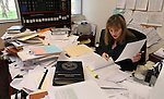 Nevada Chief Deputy Legislative Counsel Eileen O'Grady works on bill amendments on Friday, April 15, 2011, at the Legislature in Carson City, Nev. Hundreds of bills were processed Friday as lawmakers met the deadline for bills to advance out of committee in their house of origin. (AP Photo/Cathleen Allison)