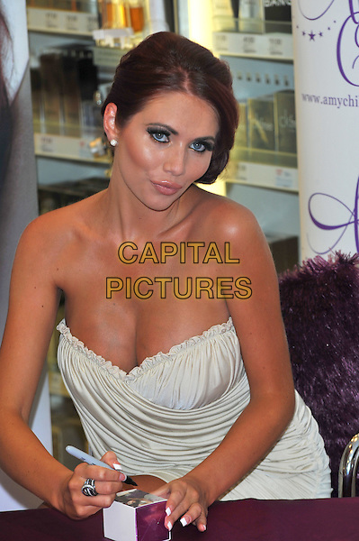 Amy Childs launches her debut fragrance 'Amy Childs' at Boots London, England..August 15th, 2012.half length dress cleavage white strapless  .CAP/CJ.©Chris Joseph/Capital Pictures.