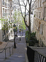 A long staircase connects the hilltop of Montmartre with the Paris, France streets below.
