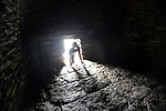 SKELLIGS ROCKS IRELAND: A tourist looks inside the stone hut on Skellig Micheal where filming of Star Wars is due to take place in September.<br /> Photo: Don MacMonagle