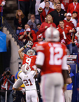 Ohio State Buckeyes wide receiver Devin Smith (9) catches a touchdown pass from Ohio State Buckeyes quarterback Cardale Jones (12) in the third quarter of the Big Ten Championship game between the Ohio State Buckeyes and the Wisconsin Badgers at Lucas Oil Stadium in Indianapolis, Saturday night, December 6, 2014. As of half time the Ohio State Buckeyes led the Wisconsin Badgers 38 - 0. (The Columbus Dispatch / Eamon Queeney)