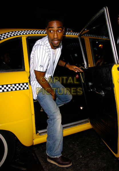 SIMON WEBBE.The Home Run Baseball themed party, Embassy Club, London, UK..November 12th, 2006.Ref: CAN.full length car cab taxi yellow jeans denim white striped top.www.capitalpictures.com.sales@capitalpictures.com.©Can Nguyen/Capital Pictures