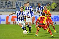 VOETBAL: ABE LENSTRA STADION: HEERENVEEN: 30-11-2013, SC Heerenveen - Go Ahead Eagles, uitslag 3-1, Magnus Eikrem (#18 | SCH), Xander Houtkoop (#11 | GAE), ©foto Martin de Jong