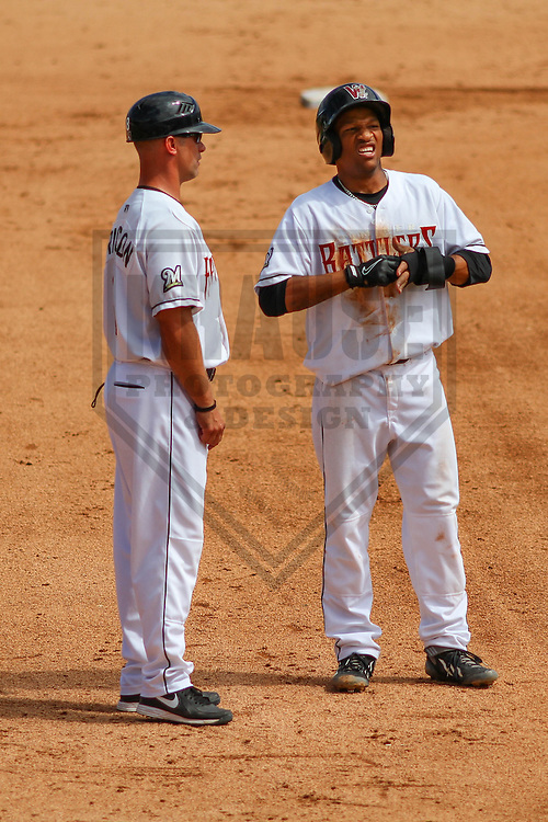 APPLETON - August 2014: Matt Erickson (8) and Johnny Davis (9) of the Wisconsin Timber Rattlers during a game against the Beloit Snappers on August 26th, 2014 at Fox Cities Stadium in Appleton, Wisconsin.  (Photo Credit: Brad Krause)