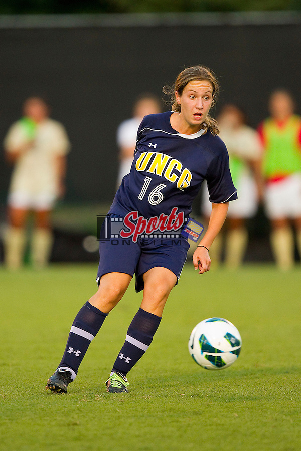 Karin Sendel (16) of the UNCG Spartans controls the ball during first half action against the Wake Forest Demon Deacons at Spry Soccer Stadium on August 24, 2012 in Winston-Salem, North Carolina.  The Spartans defeated the Demon Deacons 1-0.  (Brian Westerholt / Sports On Film)