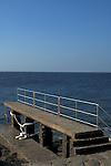 Concrete jetty, with metal handrail,La Caleta, El Hierro, Canary Islands,