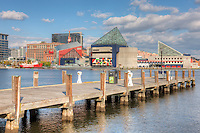 A view of the  National Aquarium, Baltimore under a partly cloudy sky in Baltimore, Maryland.