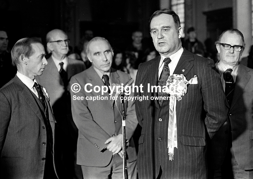 Vanguard Unionist politician, William Craig, makes victory speech, at City Hall, Belfast, N Ireland, after winning the East Belfast seat in the 28th February 1974 UK General Election. Also in the photo are Stanley McMaster, Ulster Unionist candidate, David Bleakley, N Ireland Labour Party candidate, and Des Gillespie, SDLP candidate. 197402180130k.<br />