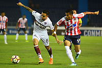 BARRANQUIILLA - COLOMBIA, 24-07-2018: Luis Diaz Marulanda (Der) del Atlético Junior de Colombia disputa el balón con Fernando Barrientos (Izq) jugador de Lanús de Argentina durante partido de la segunda fase, llave 13, por la Copa CONMEBOL Sudamericana 2018 jugado en el estadio Metropolitano Roberto Meléndez de la ciudad de Barranquilla. / Luis Diaz Marulanda (R) player of Atlético Junior of Colombia struggles the ball with Fernando Barrientos (L) player of Lanus of Argentina during match of the second phase, key 13, for the Copa CONMEBOL Sudamericana 2018played at Metropolitano Roberto Melendez stadium in Barranquilla city.  Photo: VizzorImage / Alfonso Cervantes / Cont
