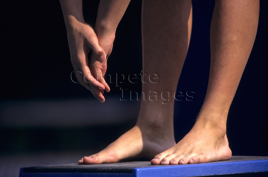 Swimmer standing on a diving board