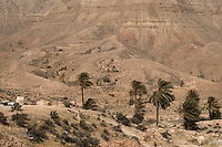 Jebel Nefusa, Jennawin, near Jadu, Libya - Terraces and water catchment basins behind berms allow palm trees to grow in arid region.  A windy day.