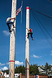 USA, Alaska, Ketchikan, two men race to the top during the Great Alaskan Lumberjack Show