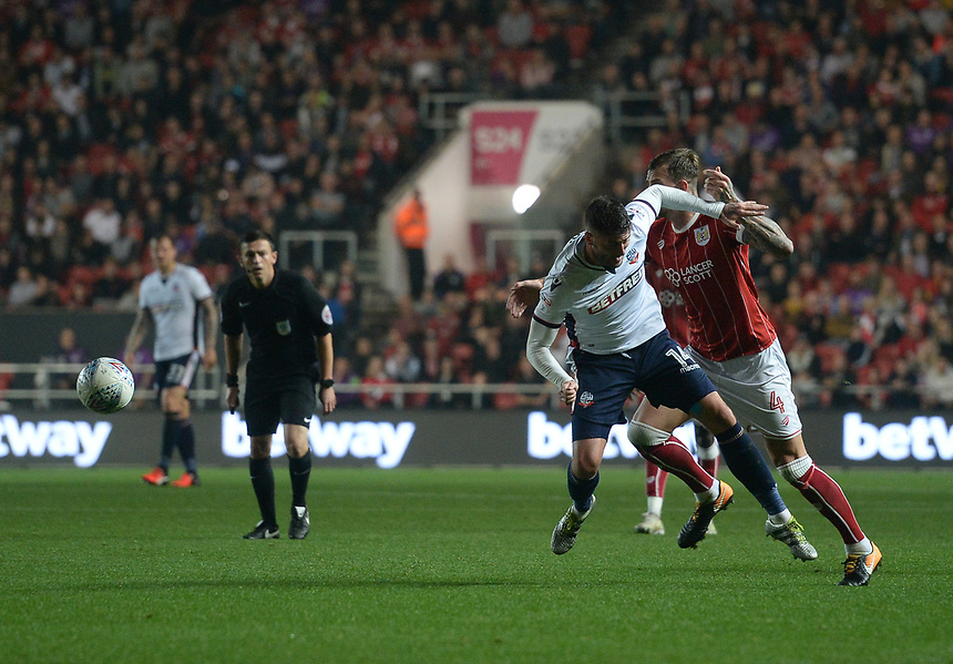 Bolton Wanderers' Gary Madine is fouled by Bristol City's Aden Flint<br /> <br /> Photographer Ian Cook/CameraSport<br /> <br /> The EFL Sky Bet Championship - Bristol City v Bolton Wanderers - Tuesday 26th September 2017 - Ashton Gate Stadium - Bristol<br /> <br /> World Copyright &copy; 2017 CameraSport. All rights reserved. 43 Linden Ave. Countesthorpe. Leicester. England. LE8 5PG - Tel: +44 (0) 116 277 4147 - admin@camerasport.com - www.camerasport.com