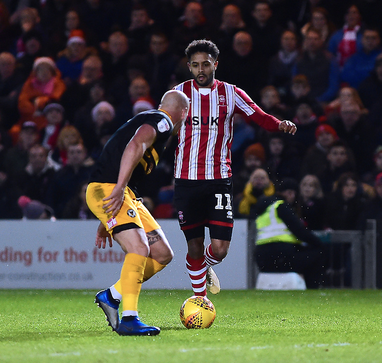Lincoln City's Bruno Andrade runsa at Newport County's David Pipe<br /> <br /> Photographer Andrew Vaughan/CameraSport<br /> <br /> The EFL Sky Bet League Two - Lincoln City v Newport County - Saturday 22nd December 201 - Sincil Bank - Lincoln<br /> <br /> World Copyright © 2018 CameraSport. All rights reserved. 43 Linden Ave. Countesthorpe. Leicester. England. LE8 5PG - Tel: +44 (0) 116 277 4147 - admin@camerasport.com - www.camerasport.com
