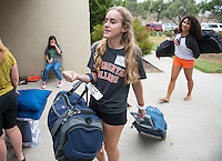 Amy Pino '18 helps new students move into Braun Hall during Orientation, Aug. 21, 2015.<br />