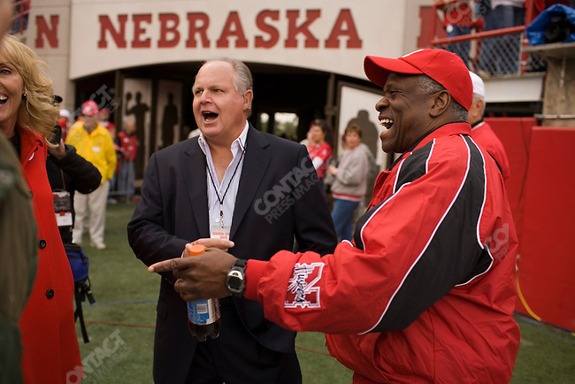 Supreme Court Justice Clarence Thomas (right) and radio personality Rush Limbaugh (center) talk on the sidelines before The University of Nebraska vs. The University of Southern California football game. Lincoln, Nebraska, September 15, 2007.