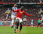 Ahmed Hegazi of West Bromwich Albion holds off Romelu Lukaku of Manchester United during the premier league match at the Old Trafford Stadium, Manchester. Picture date 15th April 2018. Picture credit should read: Simon Bellis/Sportimage