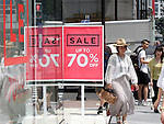 """July 1, 2016, Tokyo, Japan - Shoppers walk on the road in Tokyo's Ginza district on Friday, July 1, 2016, while an apparel shop displays a large """"Sale"""" sign. Japan's consumer price index (CPI) fell 0.4 percent in May from previous year for the third straight month and the biggest drop in three years.  (Photo by Yoshio Tsunoda/AFLO) LWX -ytd-"""