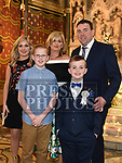 Aaron McKenna from Scoil Aonghuasa who recieved First Holy Communion at St. Peter's church with parents Danny and Stephanie, brother Cian ane sister Lauren. Photo:Colin Bell/pressphotos.ie