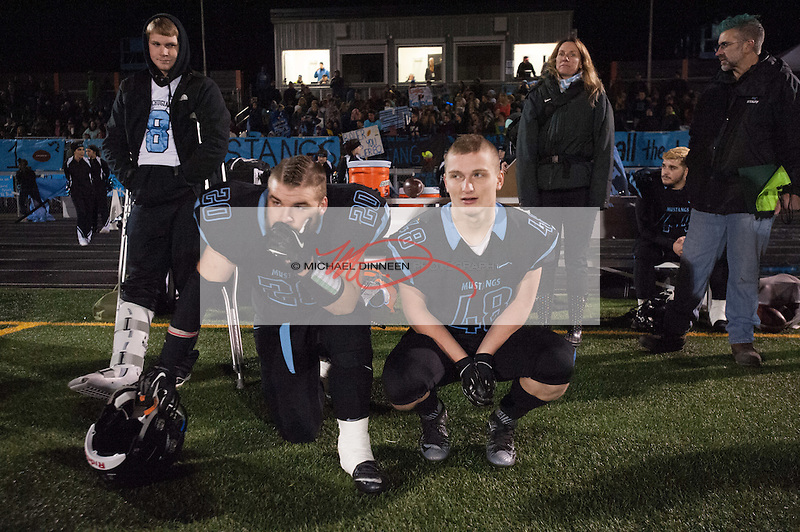 Chugiak's Merrick Johnson and Peter Mrugula contemplate the game in it's late stages. Photo for the Star by Michael Dinneen