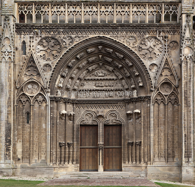 Dean's Portal (Portail du Doyen), c.1255-80, Tympanum depicts story of St Thomas Becket (c.1118-70), South facade, Bayeux Cathedral (Notre Dame de Bayeux), 11th-19th century, Bayeux, France. In Bayeux Cathedral, dedicated 1077, William the Conqueror forced Harold to take the oath which led to the Norman Conquest of England. After a 12th century war between William's sons the cathedral was reconstructed. Gothic and Neo-Gothic sections were added 13th-19th centuries. Photograph by Manuel Cohen.