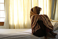 An acid victime sitting on her bed at Acid Survivors Foundation at Islamabad, Pakistan-2009