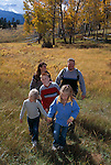 Family of five happy to be outdoors hiking in fall-colored meadow, Rocky Mtn Nat'l Park,CO
